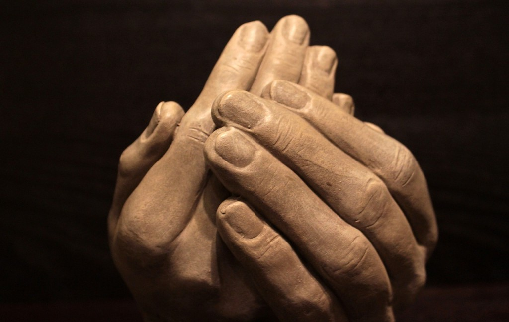 kindness as shown by interwoven hands