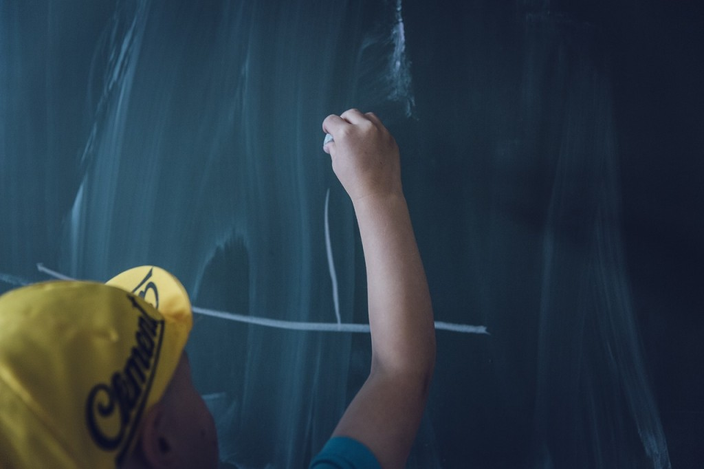 a child writing on the board