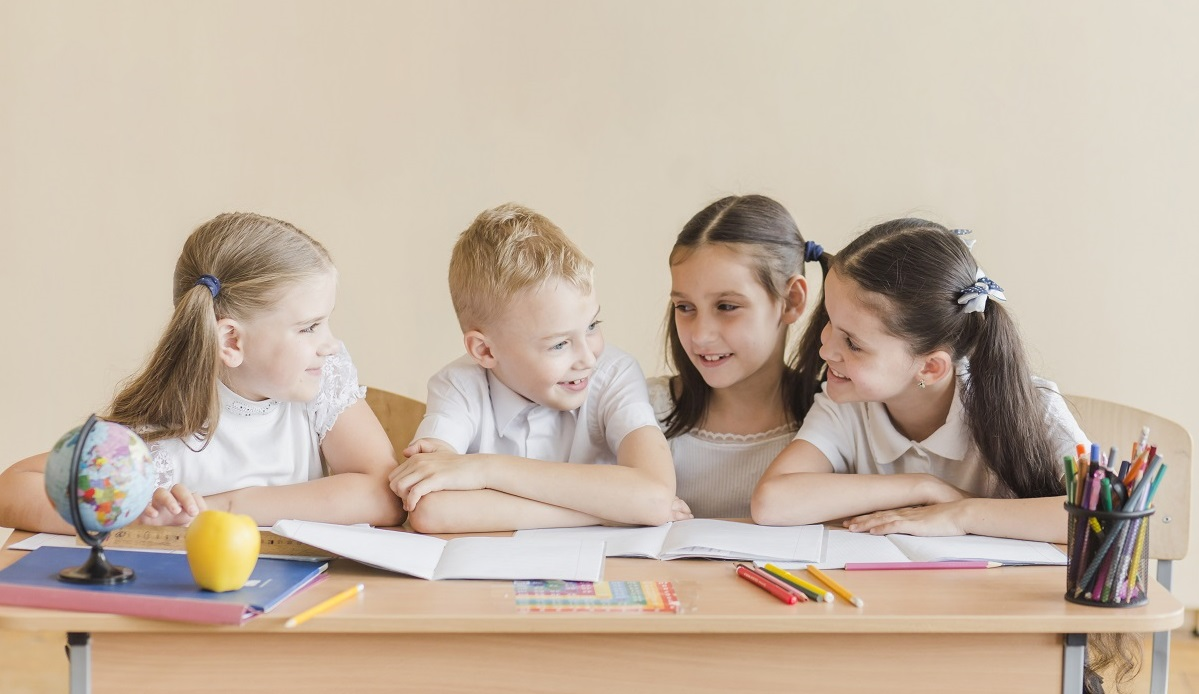 cheerful-pupils-speaking-during-lesson
