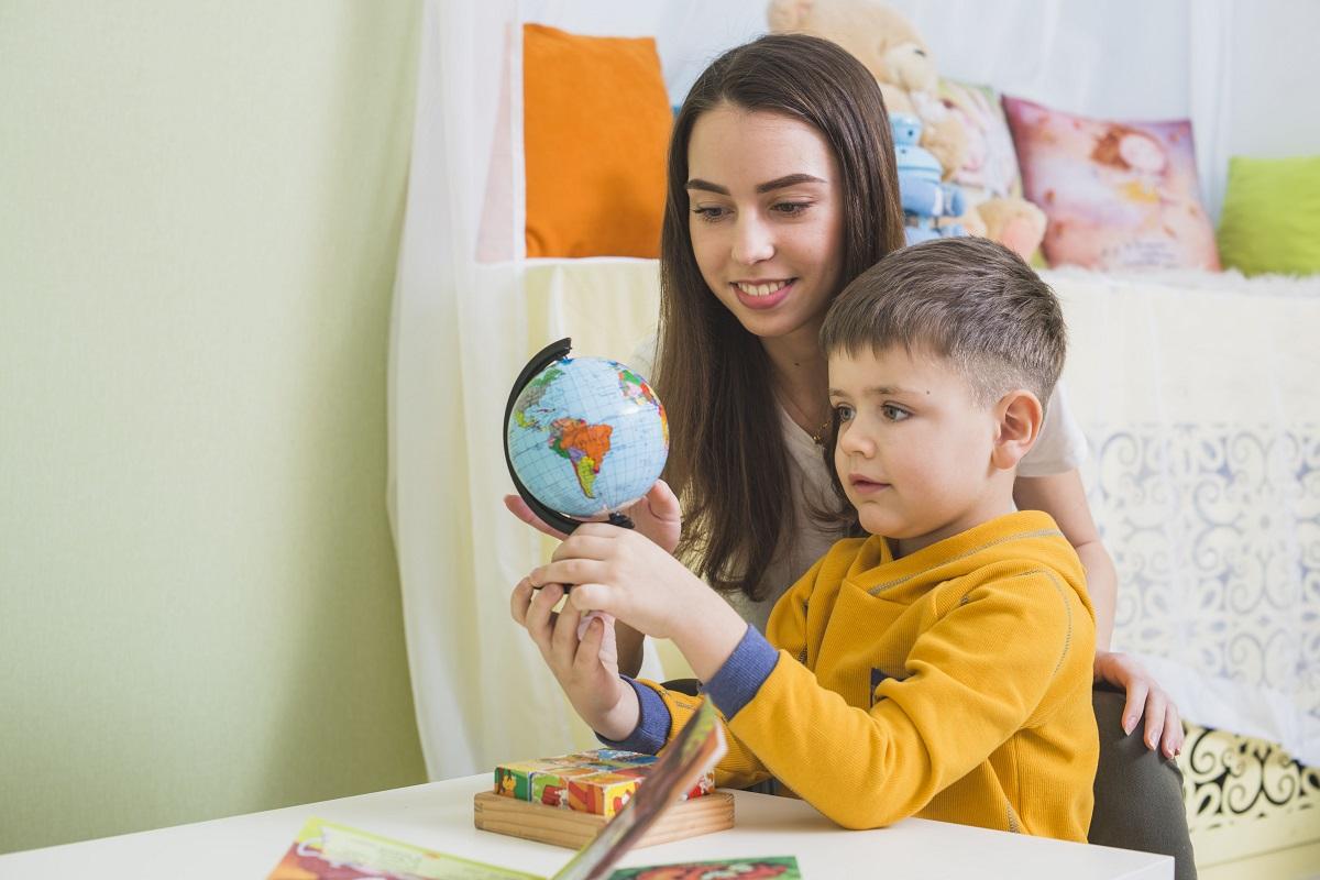 mom-teaching-son-globe